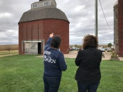 Kari points out the corn crib roof to Kathy.